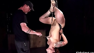 Chained and suspended redhead slave