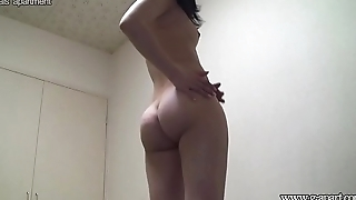 Japanese girl takes off see through lingerie and put on army clothes