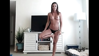 Fit girl having sexy yoga show