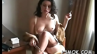 Busty sweetheart playing with her titties whilst smoking a cigarette
