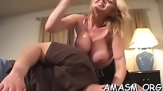 Busty female smothering man with amazing titjob on web camera