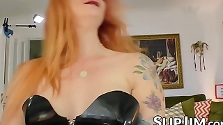Spicy redhead in sexy latex costume spreads wide for senior