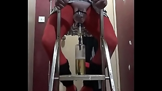 crossdressing sissy pissing in a bottle from on a ladder drinks the lot