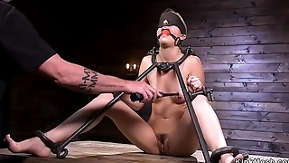 Babe in metal device bondage doggy