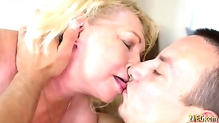 Horny blonde granny enjoys hard cock in her vagina